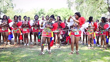 Dozens of topless African girls kick dance